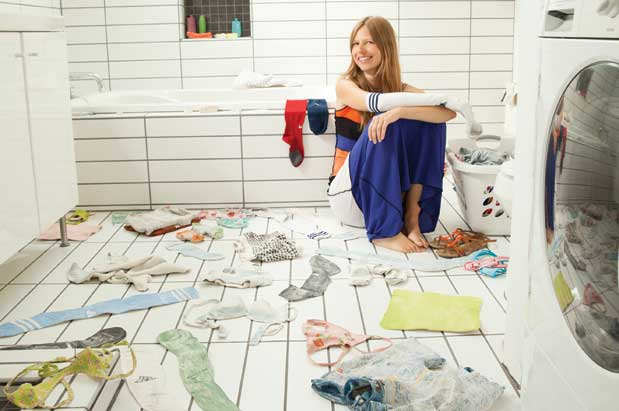 Artist Klara Glosova, surrounded by her ceramic laundry, photographed in her home on July 18, 2013, by Hayley Young