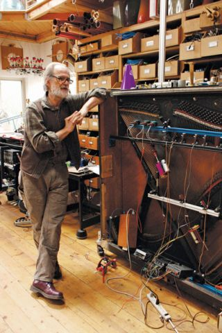 Local sound sculptor Trimpin in his Madrona studio with one of his deconstructed pianos