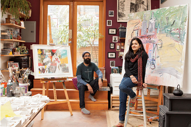 Deep and Ameen Dhillon in their backyard Ballard studio amid work by various artists, such as Heather Aston (print on left easel) and Samer Kurdi (right easel)