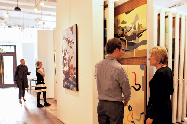 SAM Gallery exhibitions director Barbara Shaiman (right) shows off the rentable art