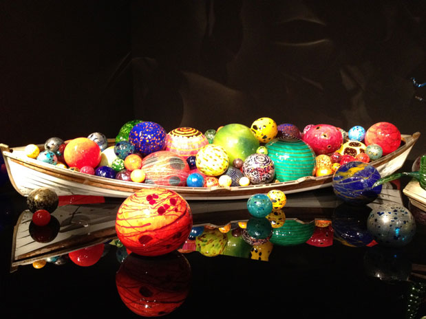 A boat full of glass floats on display at Chihuly Garden and Glass
